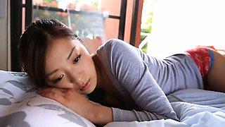 Divine Asian beauty Eri Wada is having fun in her bedroom