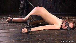 Slave in device bondage gets caned