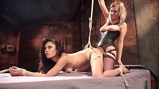 Annie Cruz gets dominated with strapon, dildo and vibrator by Cherry Torn