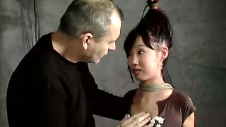Master ties up leggy oriental chick before pussy punishment