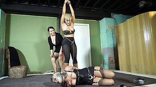 Dominant mistress captures two women