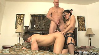 Brunette chick Roxanne Hall fucks John Magnum and Tom Moore with a strap on