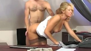 Mature secretary seduces the boss