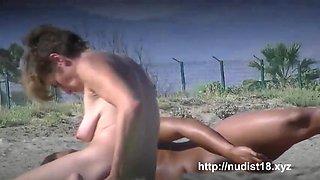 nudist beach voyeur babe takes naked sunbathing