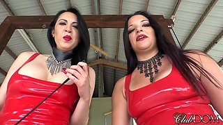 Two hot sluts in red latex suits talk dirty and tease