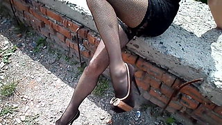 Mesh stockings and pink panties under the dress