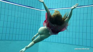 Raunchy ginger slut unveils her tight body in the pool