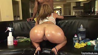 Bootylicious blonde Latina, Katie Cummings, oils up her big bubble butt outside