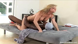 Kayla Quinn uses her big boobs and charm to seduce a young black big cock.