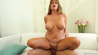 Tanned appetizing housewife in her 50s rides strong cock on top