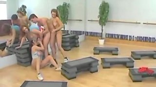 Strapon orgy at the gym
