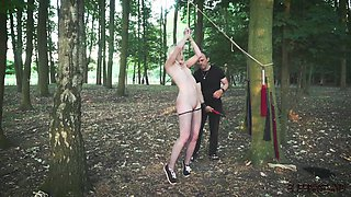 Collared slave foil wrapped to a tree